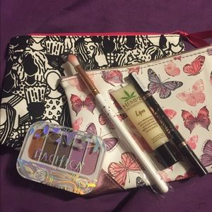 Bundle of 2 ipsy makeup bags and samples